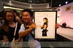"""She left the stage for a break. Durign that time, the emcee called three contestants on stage who has any of Charice's ringtone on their mobile phones. The emcee then asked each to sing a Charice song followed by asking them to create the biggest """"Pyramid"""" gesture using their body. The winner took home a Charice framed photograph duly autographed by her. The winner...and look at the lady beside him =)"""